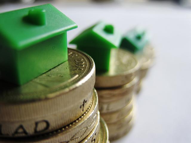 maison monopoly sur pièces de monnaie